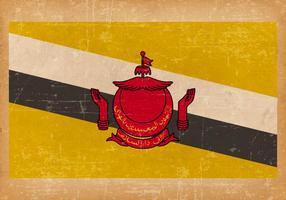 Drapeau de Brunei sur fond grunge vecteur