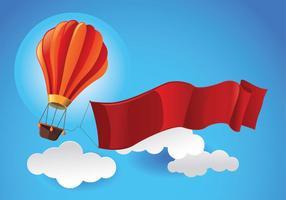 Ballon à air chaud dans le ciel avec vecteur de ruban blanc