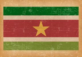 Drapeau grunge du Suriname vecteur
