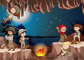 scène avec un groupe de scouts explorant la grotte