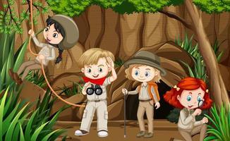 scène avec un groupe de scouts explorant la grotte vecteur