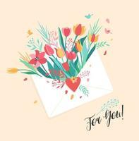 bouquet de fleurs dans l'enveloppe blanche