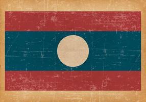 Le vieux drapeau grunge du Laos vecteur