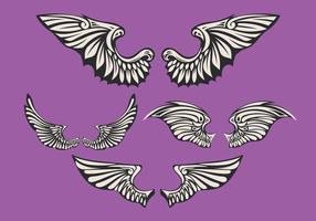 Ensemble d'ailes blanches avec fond violet vecteur