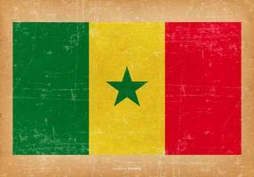 Drapeau grunge du Sénégal vecteur