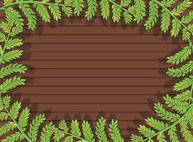 vue de dessus de la table en bois vierge avec des éléments de feuilles