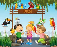 enfants jouant avec des oiseaux perroquets dans la scène du zoo vecteur