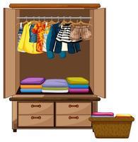 Vêtements suspendus dans une armoire avec panier de vêtements sur fond blanc
