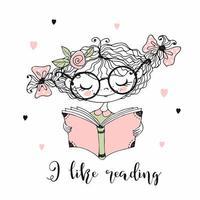 une jolie petite fille lit un livre.