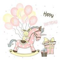un cheval jouet licorne et des ballons et des cadeaux.