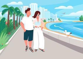 couple amoureux marchant le long du front de mer