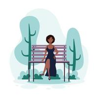 jeune femme assise sur la chaise de parc