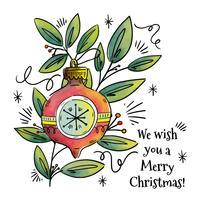 Branche verte mignonne avec ornements et boule de Noël