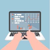 mains tapant sur un ordinateur portable avec des graphiques et des données
