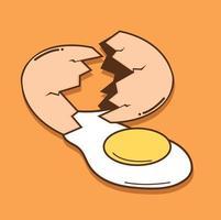 œuf cassé avec du jaune s'échappant de la coquille