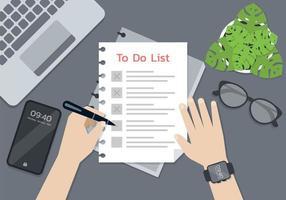 personne qui rédige une liste de choses à faire dans un bureau