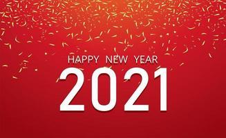 bonne année 2021 et confettis sur rouge