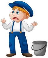 Un jeune garçon en uniforme de fermier sur fond blanc