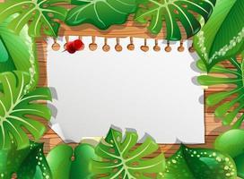 vue de dessus du papier blanc sur la table avec des éléments de feuilles