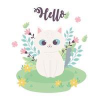 mignon petit chat fleurs assis dans le dessin animé de prairie
