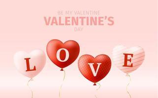 mot d'amour sur des ballons coeur réalistes