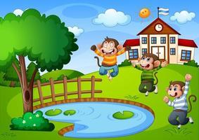trois petits singes dans la scène de la nature avec bâtiment scolaire