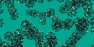toile de fond de vecteur vert clair avec des flocons de neige de Noël.