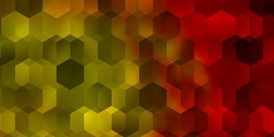texture de vecteur rouge et jaune clair avec des hexagones colorés.