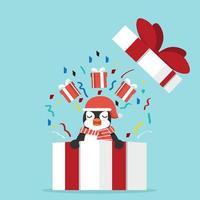 pingouin drôle avec boîte-cadeau vecteur