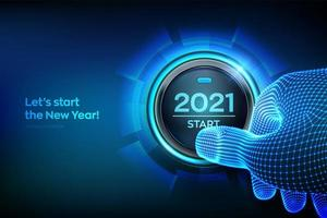 Début 2021. doigt sur le point d'appuyer sur un bouton avec le texte 2021 start. bonne année. nouvelle année deux mille vingt et un concept à venir.