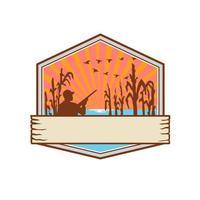 Chasseur de canard en bouclier de champ de maïs rétro