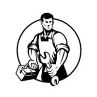 Mécanicien automobile tenant une clé et une boîte à outils