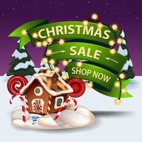 vente de noël, boutique maintenant, bannière de réduction avec guirlande enveloppée de ruban volumétrique, paysage d'hiver et maison en pain d'épice de noël vecteur