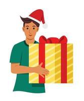 l'homme tient une grande boîte de cadeau.