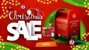 Vente de Noël, bannière de réduction rouge et verte en papier découpé avec des guirlandes, des boules de Noël, un bouton et une boîte aux lettres du père Noël avec des cadeaux vecteur