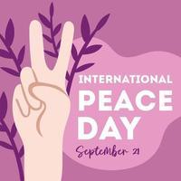 journée internationale de la paix lettrage avec signe de paix de la main vecteur