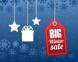 grande affiche de vente d'hiver avec étiquette et cadeau avec des étoiles suspendues vecteur