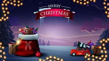 joyeux Noël. Belle carte postale de voeux avec sac de père Noël avec des cadeaux, voiture vintage rouge portant arbre de Noël et paysage d'hiver sur le fond