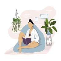 Jeune femme lisant un livre sur le canapé vecteur