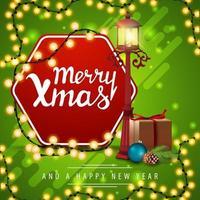 Joyeux Noël et bonne année, carte de voeux carrée verte avec lanterne de poteau, cadeau, branche d'arbre de Noël avec un cône et une boule de Noël vecteur