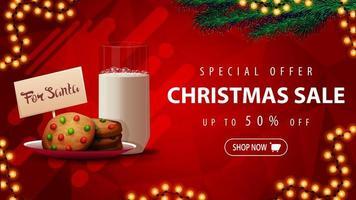 offre spéciale, vente de Noël, jusqu'à 50 rabais, belle bannière de réduction rouge avec des branches d'arbre de Noël, guirlande et biscuits avec un verre de lait pour le père Noël