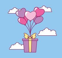 célébration de la saint valentin avec des ballons et une boîte cadeau