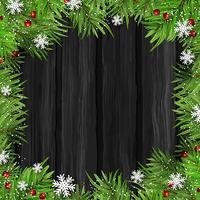 Branches d'arbres de Noël sur fond de bois