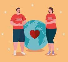 Couple de bénévoles portant des chemises rouges avec la planète mondiale et le cœur, la charité et le concept de don de soins sociaux