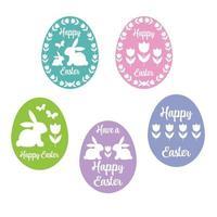 silhouettes d'oeufs de Pâques heureux avec des tulipes et des lapins