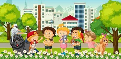 groupe d & # 39; enfants jouant avec leur animal de compagnie dans la scène du parc