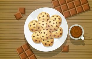 Cookies aux pépites de chocolat sur plaque avec des carrés de chocolat sur table en bois