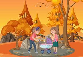 scène de parc au coucher du soleil avec mère et fille
