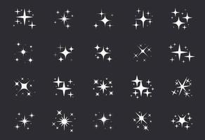 étoiles scintillantes. une étoile scintillante et des éléments scintillants sur fond noir.