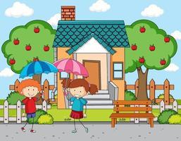 devant la scène de la maison avec deux enfants tenant un parapluie
